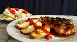 Peppered Peach Pork Chops with Garlic Potatoes and Tossed Salad